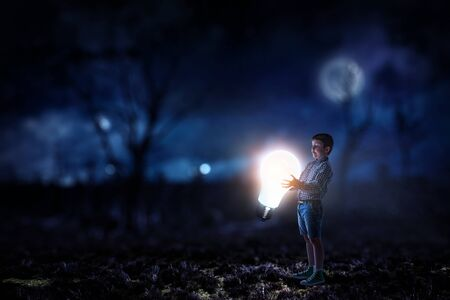 Boy holding a light bulb