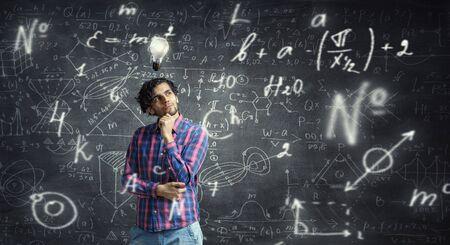 Man thinking and seeking new idea concept. Mixed media 免版税图像