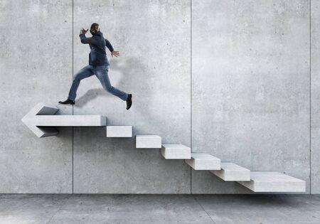 Image of businessman walking upstairs