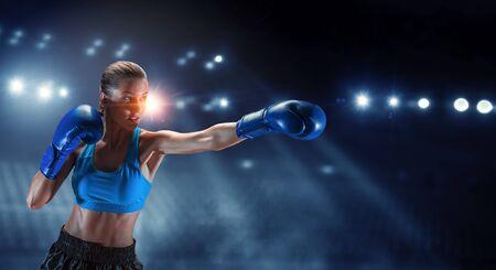 Young woman boxing. . Mixed media Stock Photo
