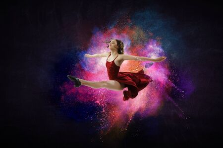 Female dancer against colourful background Stock Photo