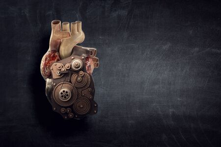 Human heart made of mechanisms and elements. Mixed media Stock fotó