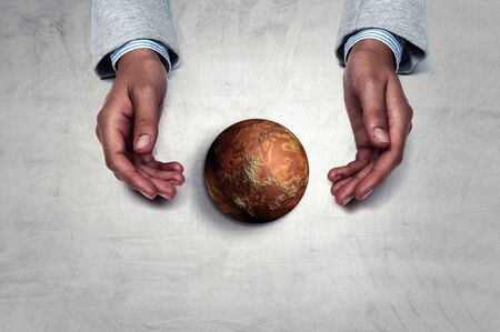 Hands holding planet . Mixed media Standard-Bild