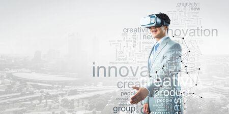 Businessman in VR glasses . Mixed media Standard-Bild
