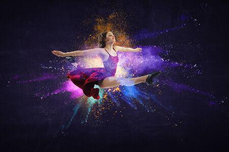 Female dancer against colourful background