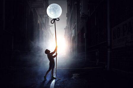 Little boy catching moon. Mixed media