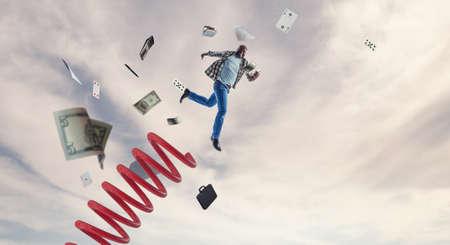 Businessman jumping on springboard . Mixed media