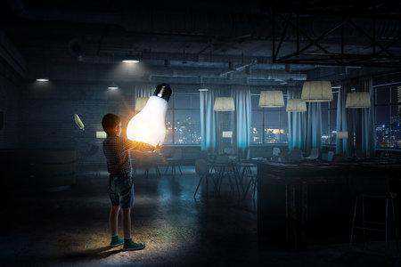 Boy with a light bulb 스톡 콘텐츠