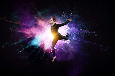 Male dancer against colourful background