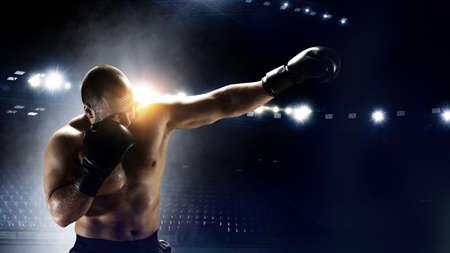 Young man boxing. . Mixed media Reklamní fotografie - 167040978