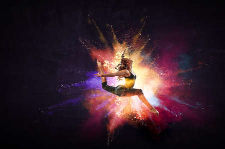 Female dancer against abstract colourful background Stock Photo