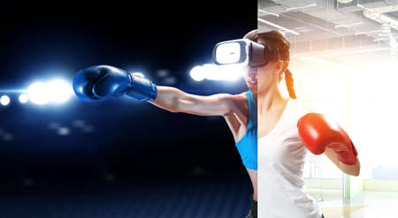 Young woman boxing in VR glasses Reklamní fotografie - 167041097