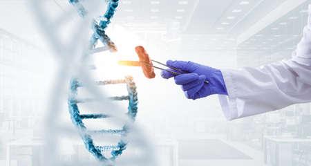 DNA molecules design with doctor hand holding pincers. Mixed media Reklamní fotografie - 167041232