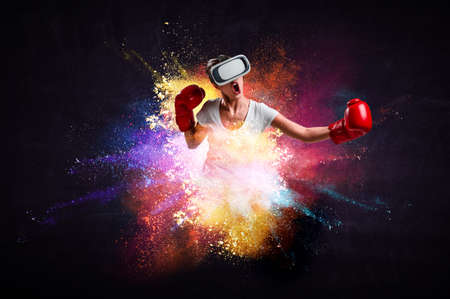 Young woman boxing in VR glasses