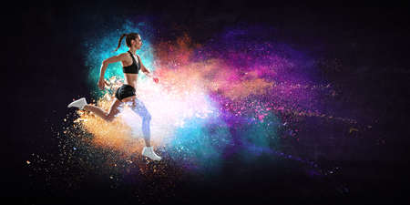 Athletic woman runner on colourful background