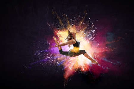 Female dancer against abstract colourful background