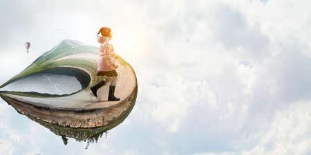 Little girl walking a landscape
