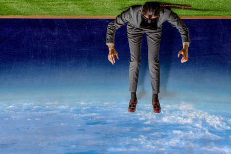 Businessman relaxing with his legs up in the sky