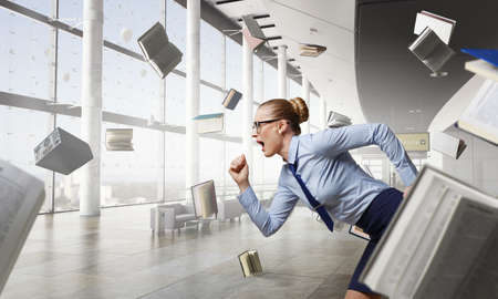 Portrait of business woman running