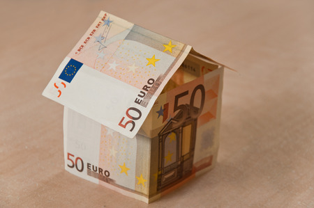 investment concept - house with money of 50 euros photo