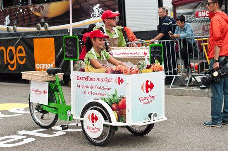 carrefour market: MULHOUSE - FRANCE - 13 th July 2014 - tour de France - carrefour market advertising Editorial