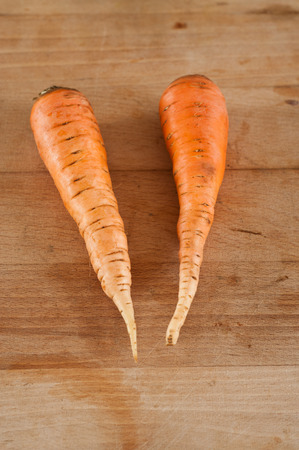 group of Carrots on wooden board photo