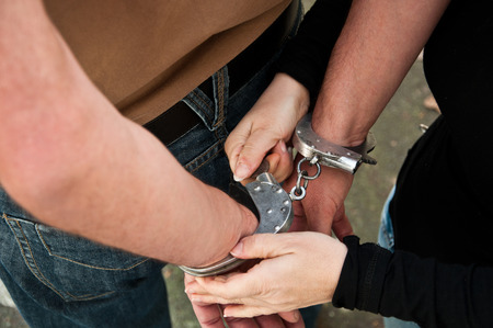 prisoner man: man handcuffed Stock Photo