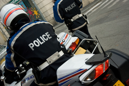 a white police motorcycle: french policeman with motorcycle back