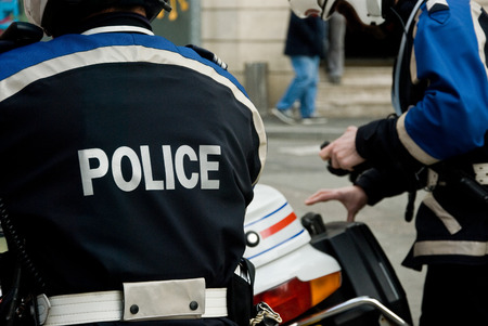 handcuffing: french policeman with motorcycle back