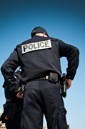 french policeman back with sky blue background photo