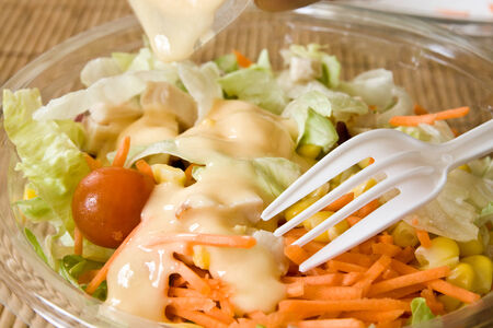 Closeup of take away bowl with fast food salad photo