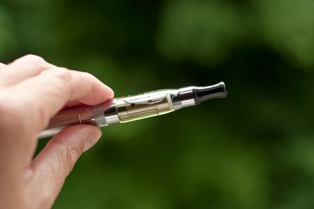 e-cigarette with hand closeup in outdoor