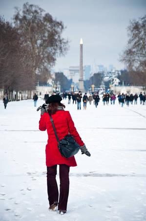 woman in tuileries garden in Paris by winter photo