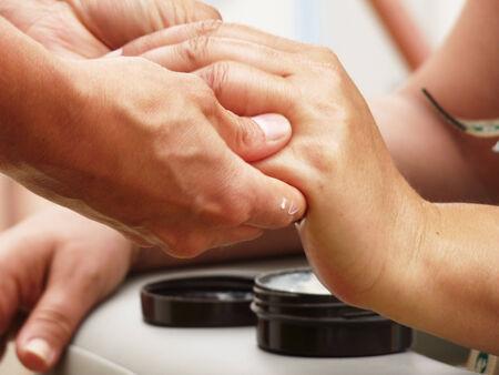 Hand shiatsu Massage closeup photo