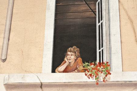 graffiti woman at the window
