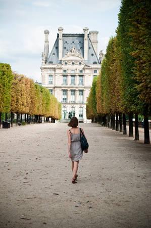 woman walking in tuileries garden in Paris photo