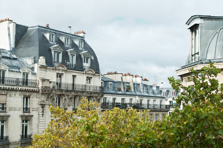 typical ancient parisian Building in Paris - France Stock Photo