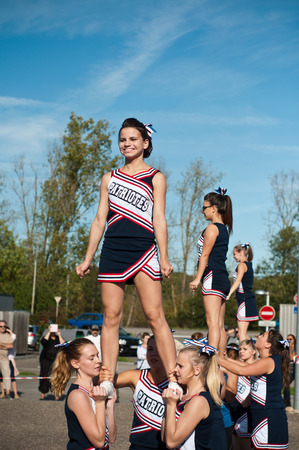 adult cheerleader: Cheerleaders in the american festifal of Lutherbach - Luterbach France on 19 October 2014 Editorial