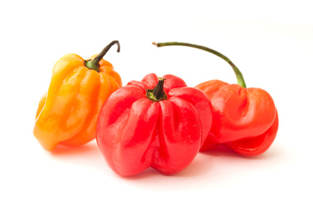 sellotape: jamaican peppers in white background Stock Photo