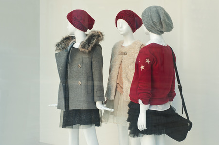 window display: mannequin winter fashion in a showroom Stock Photo