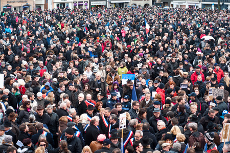 satire: MULHOUSE - France - 11 January 2015 - March against Charlie Hebdo magazine terrorism attack, on January 7th, 2015 in Paris Stock Photo