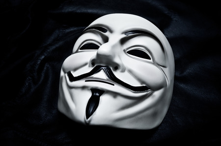 occupy wall street: Vendetta mask symbol for the online hacktivist group Anonymous