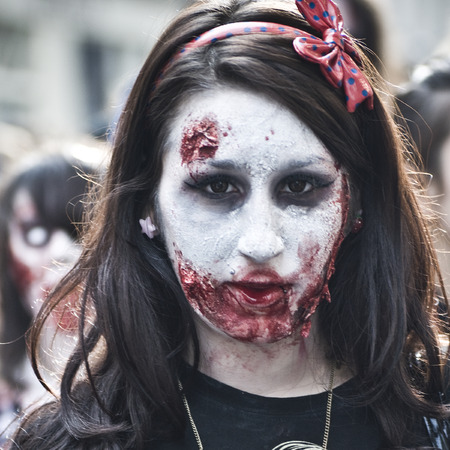 parades: Paris, France - November 16, 2010: People dressed as a zombie parades on a street during a zombie walk in Paris.