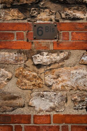 Building s private entry with number 6bis photo