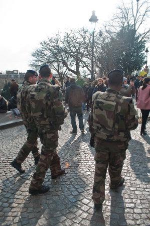 patrol: PARIS - France - 22 March 2015 - military patrol in Montmartre quarter Editorial
