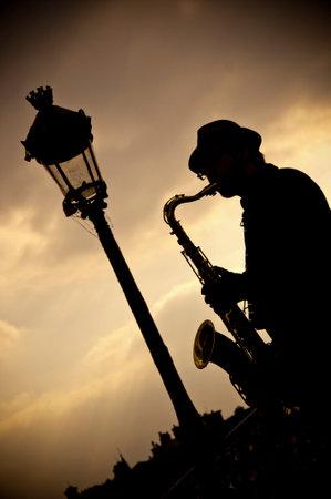 saxophonist in border Seine river in Paris Editorial