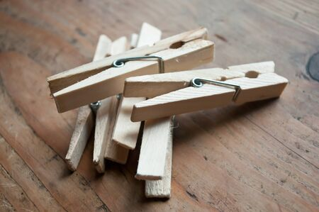 clothespins: wooden clothespins on wooden background