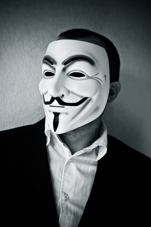 vendetta: PARIS - France - 22 April 2015 - man wearing suit businessman and Vendetta mask. This mask is a well-known symbol for the on line hacktivist group Anonymous