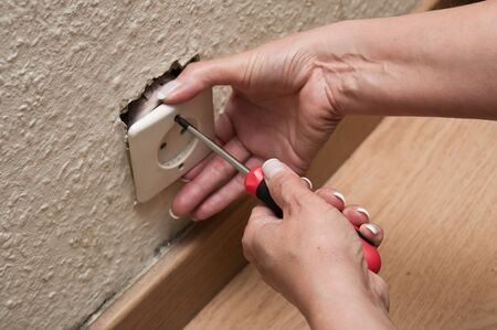 woman changing a electrical outlet photo