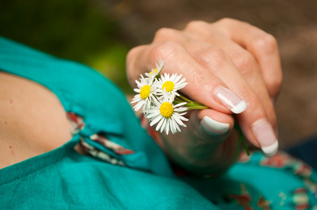 lustful: Woman with daisies on hands